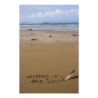 it's written in the sand on a beach poster