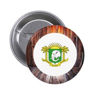 Ivory Coast flag circle on wood background 6 Cm Round Badge