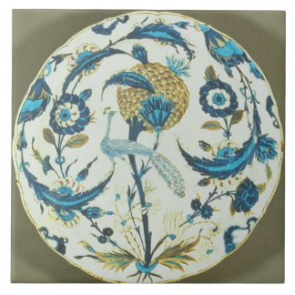 Iznik dish painted with a peacock perched among fl large square tile