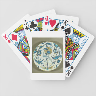 Iznik dish painted with a peacock perched among fl poker deck