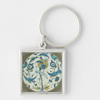 Iznik dish painted with a peacock perched among fl Silver-Colored square key ring