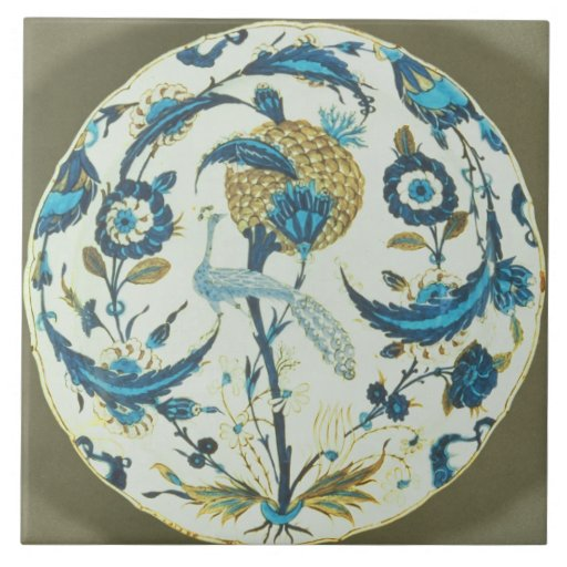 Iznik dish painted with a peacock perched among fl tile