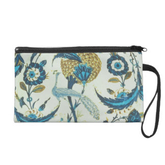 Iznik dish painted with a peacock perched among fl wristlet purses