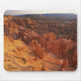 Jagged rock formations in canyon mouse mat