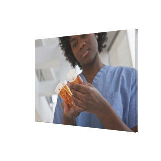 Jamaican female nurse checking pill bottles canvas print