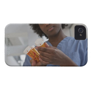 Jamaican female nurse checking pill bottles iPhone 4 Case-Mate cases