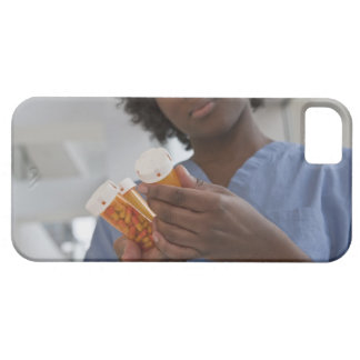 Jamaican female nurse checking pill bottles iPhone 5 cover