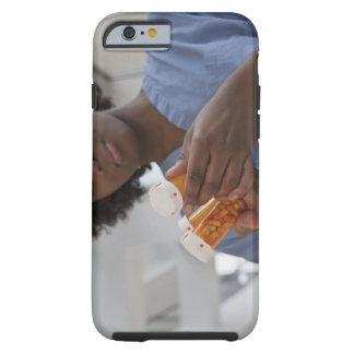 Jamaican female nurse checking pill bottles tough iPhone 6 case