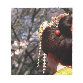 Japan, Kyoto. Rear view close-up of geisha's Notepad