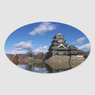 Japanese Castle surrounded by blue castle moat Oval Sticker
