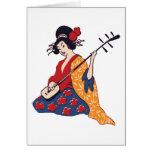 Japanese Geisha Playing a Shamisen Instrument