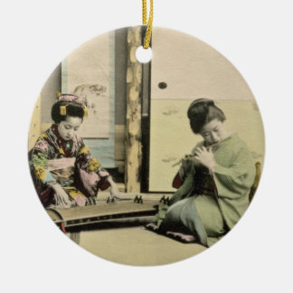 Japanese girls playing the flute, 'koto' and samis round ceramic decoration