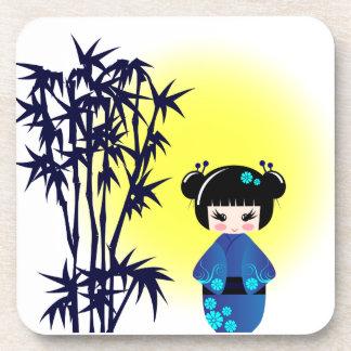 Japanese kokeshi doll at bamboo at sunrise girl coaster