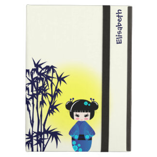 Japanese kokeshi doll at bamboo during sunrise cover for iPad air