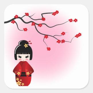 Japanese kokeshi doll at sakura blossoms square sticker
