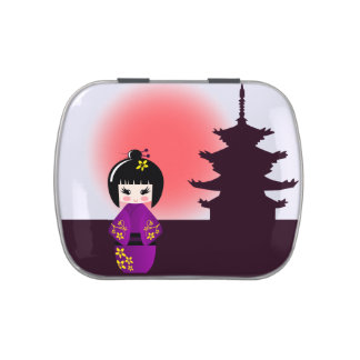 Japanese kokeshi doll at temple during sunset candy tin