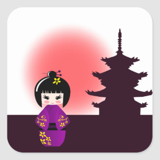 Japanese kokeshi doll at temple during sunset square sticker