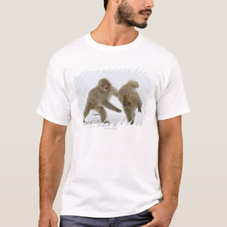 Japanese Snow Monkey cubs playing on snow T-Shirt