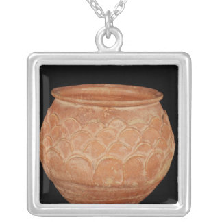 Jar decorated with overlapping applied scales silver plated necklace