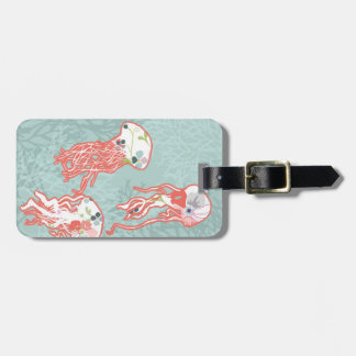 Jelly fishes on pastel blue background. luggage tag