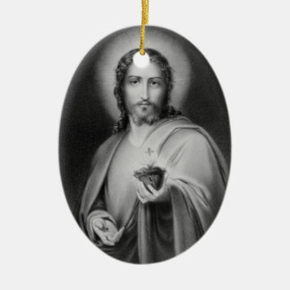 Jesus holding a sacred heart religious ornament