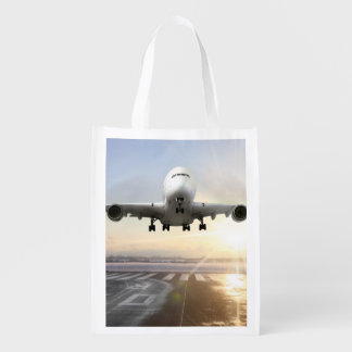 Jet Landing on Snowy Runway Reusable Grocery Bag