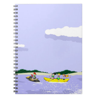 jet ski at full speed taking to a boat banana notebook