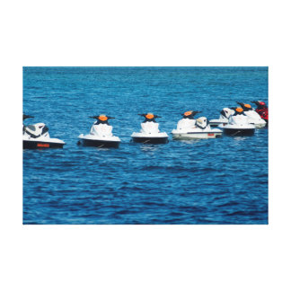 Jet skis moored in a line canvas print