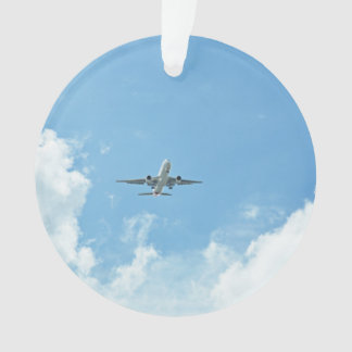 Jet Soaring Through Cloudy Sky Ornament