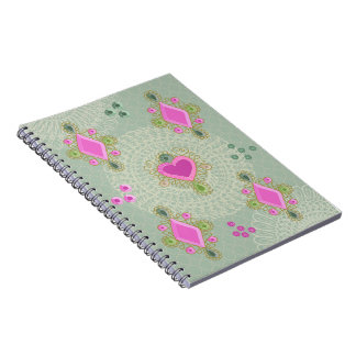 Jewels on green spiral note books