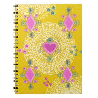 Jewels on yellow notebook