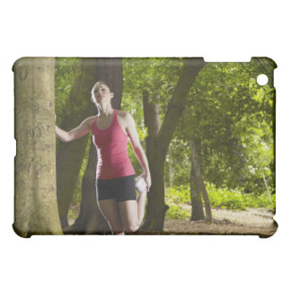 Jogger stretching in forest cover for the iPad mini