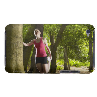 Jogger stretching in forest iPod touch cover
