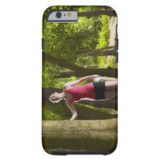 Jogger stretching in forest tough iPhone 6 case