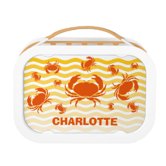 Jolly orange crabs on the sandy seashore lunchboxes