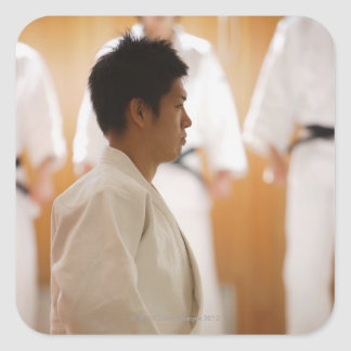 Judo Master Kneeling On a Mat Square Sticker