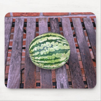 Juicy watermelon on table mouse pads