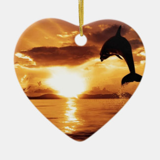 jumping dolphin with beautiful sunset over the sea christmas ornament