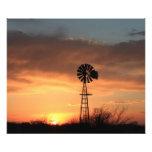 Kansas Sunset with orange sky and Windmill