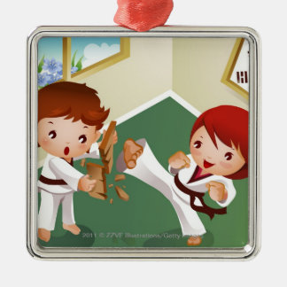 Karate boy holding wood with another breaking it Silver-Colored square decoration