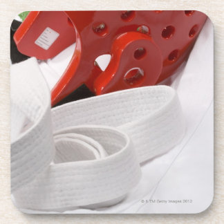 Karate gi and sparring headgear drink coaster