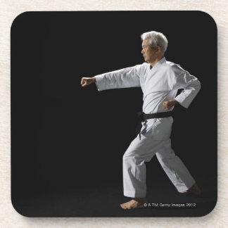 Karate master demonstrating, studio shot coaster