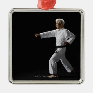 Karate master demonstrating, studio shot Silver-Colored square decoration