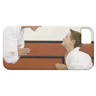 Karate teacher and boy (4-5 years) bowing to case for the iPhone 5