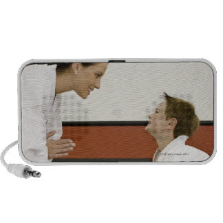 Karate teacher and boy (4-5 years) bowing to speakers