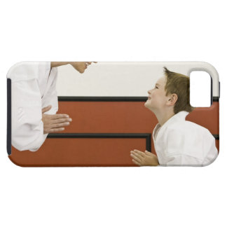 Karate teacher and boy (4-5 years) bowing to tough iPhone 5 case