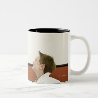 Karate teacher and boy (4-5 years) bowing to Two-Tone mug