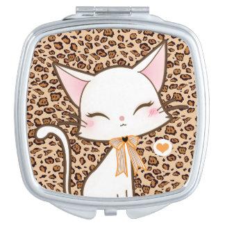 Kawaii cute white cat on leopard print background makeup mirrors