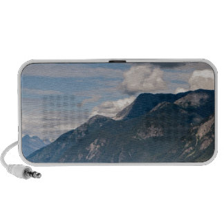 Kayakers with mountains and blue skies mini speaker
