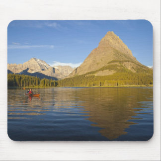 Kayaking in Swiftcurrent Lake at sunrise in the Mouse Mat
